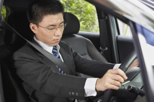 Chinese businessman inside car falling asleep